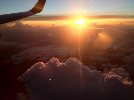 plane-sun-clouds-rf