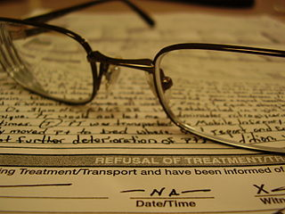 Glasses on top of a paper representing an advanced directive or living will.